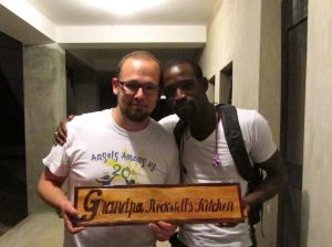 With Vaddy, the local Haitian artist who made the plaque for the kitchen
