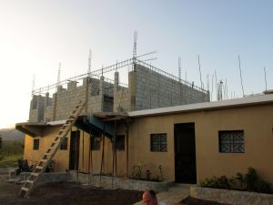 """The Hands & Feet Project's new building on the mountain at Ikondo. """"Grandpa Rockwell's Kitchen"""" will be in the room on the first level, where the furthest left window is."""