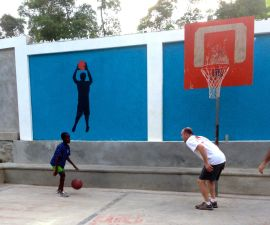 Teammate James Tompkins playing basketball with Chadieu