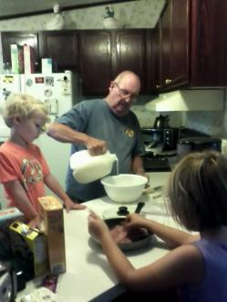 Dad in his home kitchen making a pancake breakfast for his grandkids circa 2011